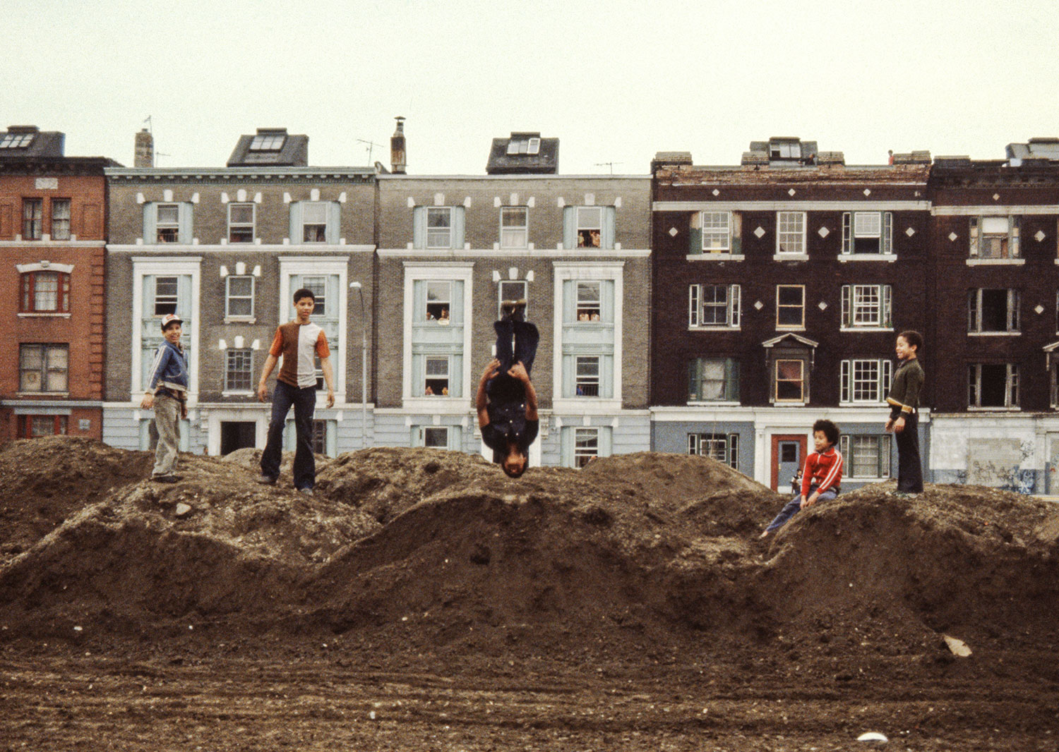 Playing on the dirt piles 1980
